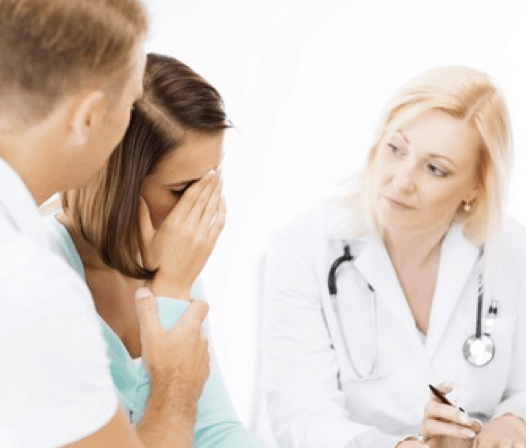 distressed woman and doctor - Military Medical Malpractice